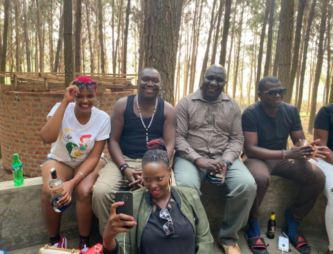 Police Spokesperson Enanga Breaks Social Distance COVID-19 Law As He Parties With Sexy Babes
